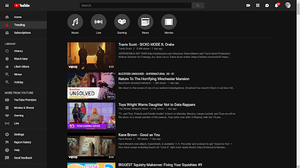 Shows the Trending Page with the Dark Theme on.