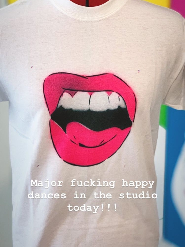 a t-shirt with a spray painted mouth on it