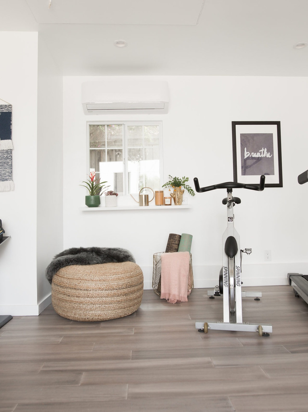 bright white home gym with decor and artwork