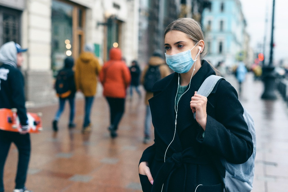 Masked woman on city street