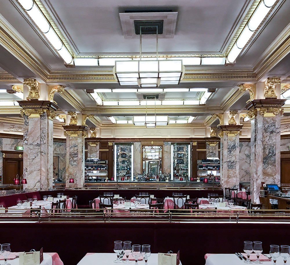 Zedel, architecture, art deco, underground, underground restaurant, below ground restaurant, bar, marble pillars, pink and white table cloth, wall mirrors, alcohol display