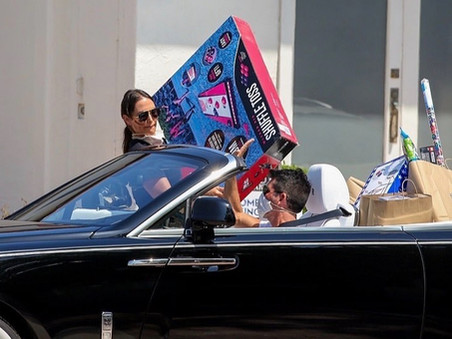 Simon Cowell and Lauren stock up on toys for Eric