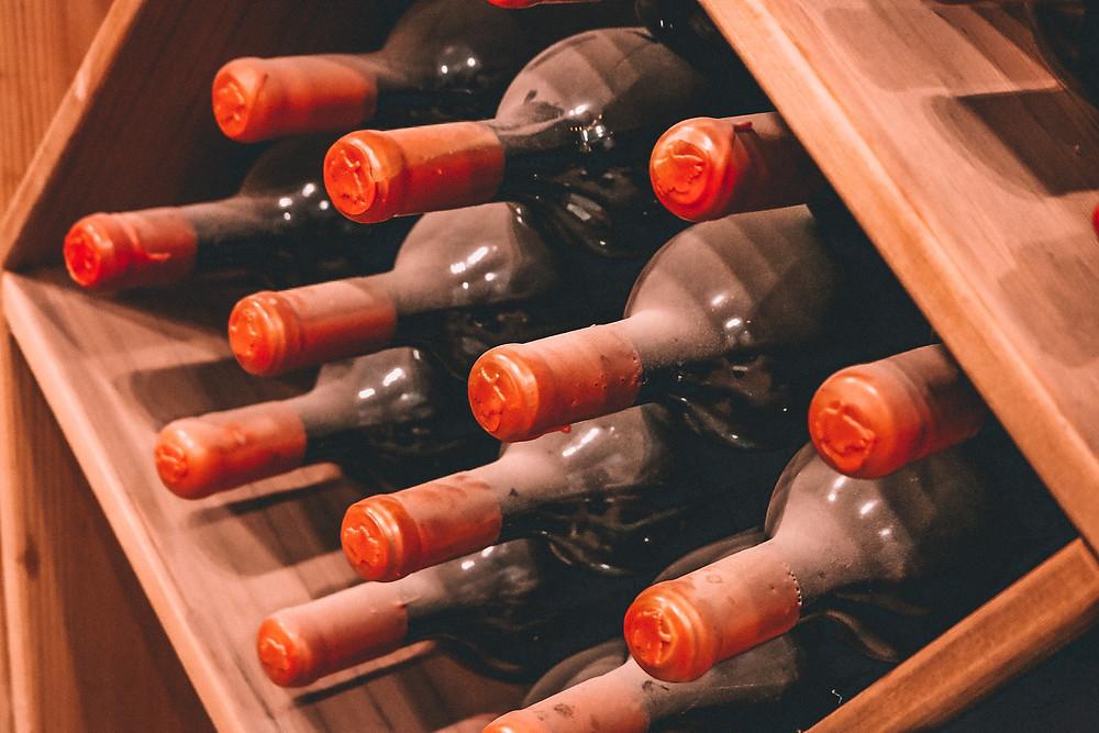 Dusty wine bottles in a cellar