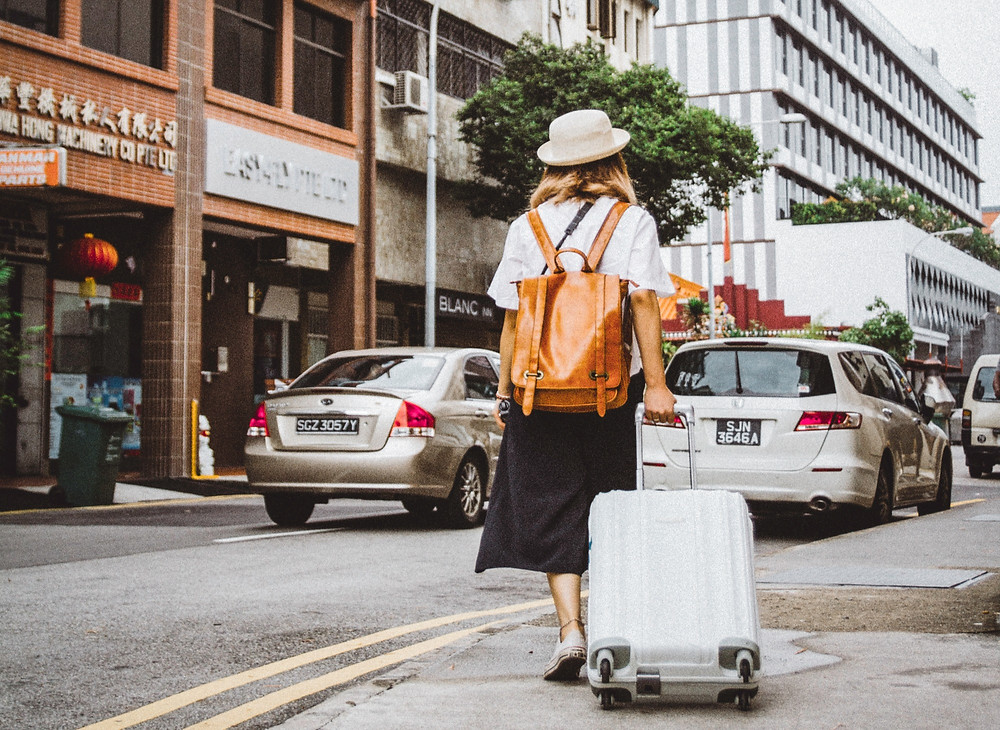 A woman moving abroad.