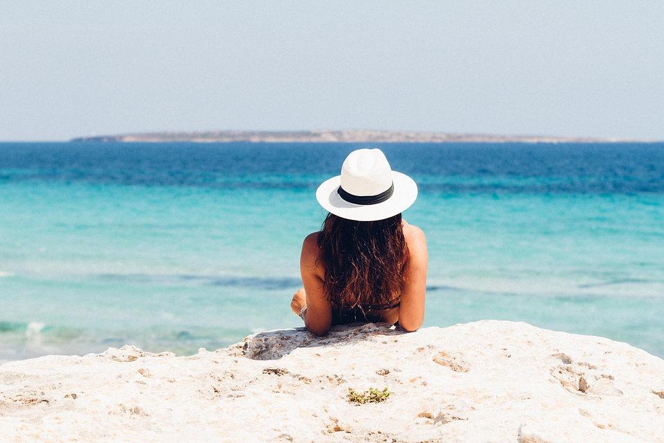 woman-lying-on-white-sand-beach-871060.j