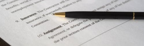 Pen on top of a contract which reads insurance