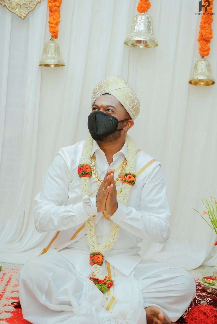 indian wedding groom with mask