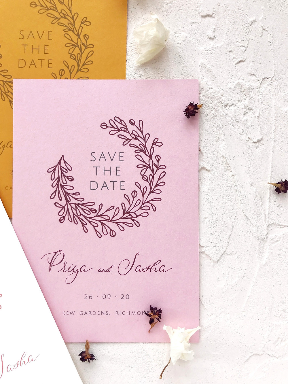 Save the Date card - Modern mustard and pink wedding stationery with an illustrated wreath and the names in calligraphy