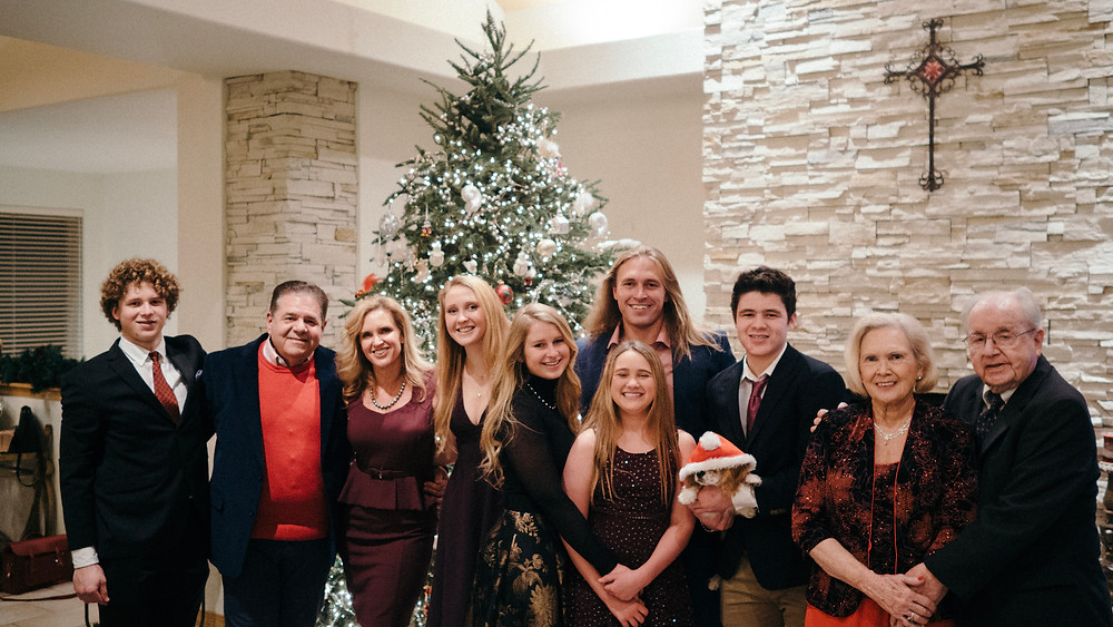 Family portrait in front of a Christmas tree