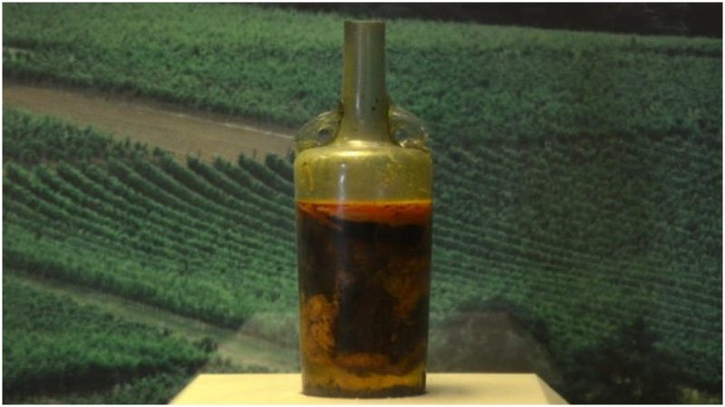 This image is of the first unopened wine bottle