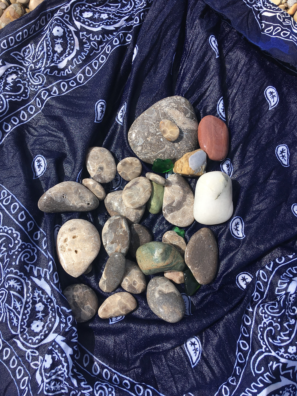 Petoskey stones, beach glass, and rocks in handkerchief