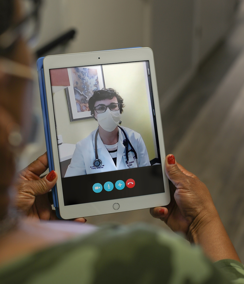 Resident using iPad to teleconference with a physician