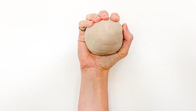 Ball of clay held in hand, Jenna Archer, Calgary, Canada