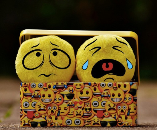 Emoji soft toys in a emoji cartoon box