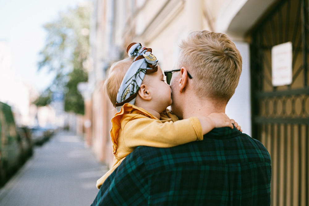 kiss for dad by daughter
