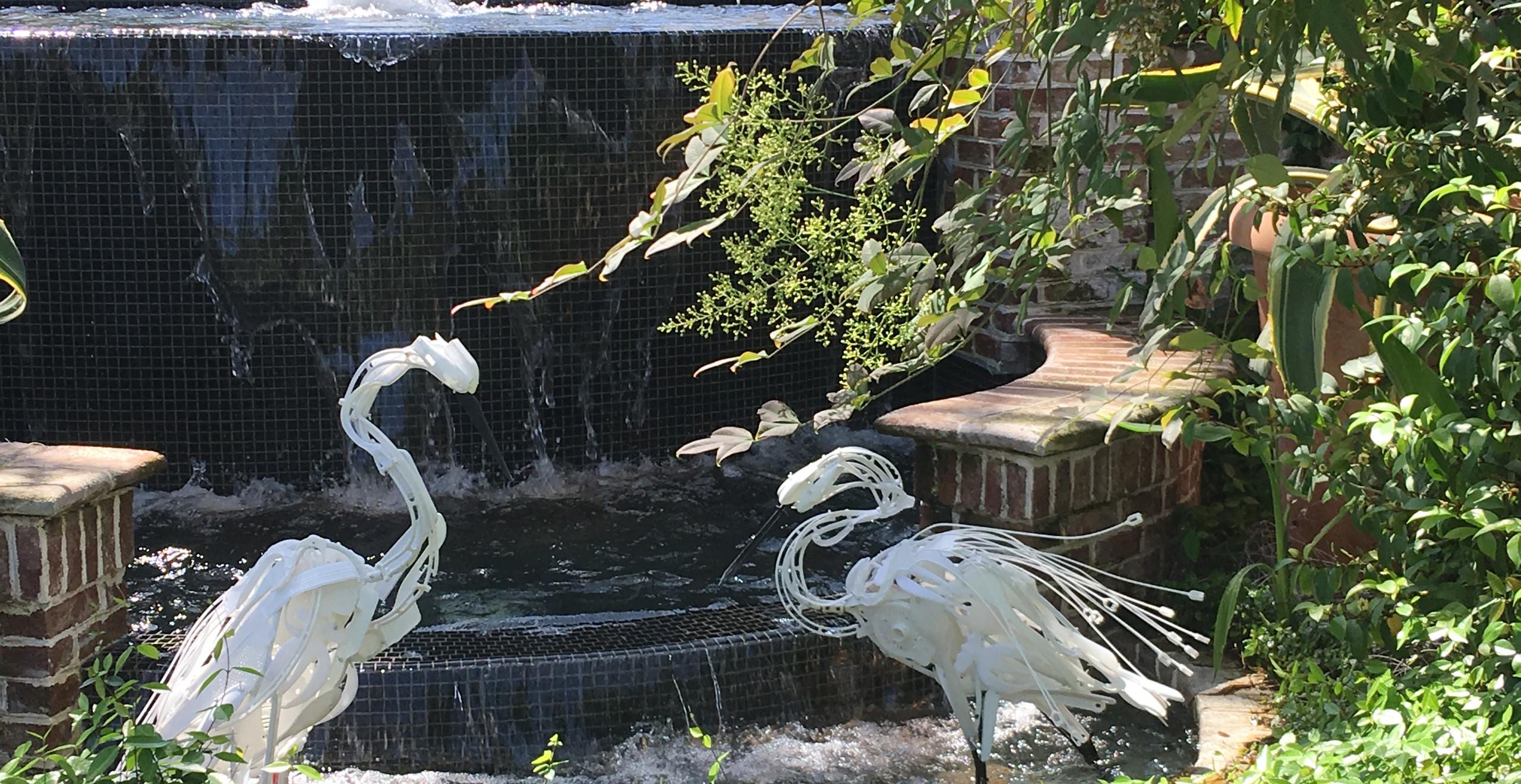 plastic cranes in water