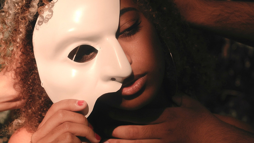 Woman's face half-covered by mask