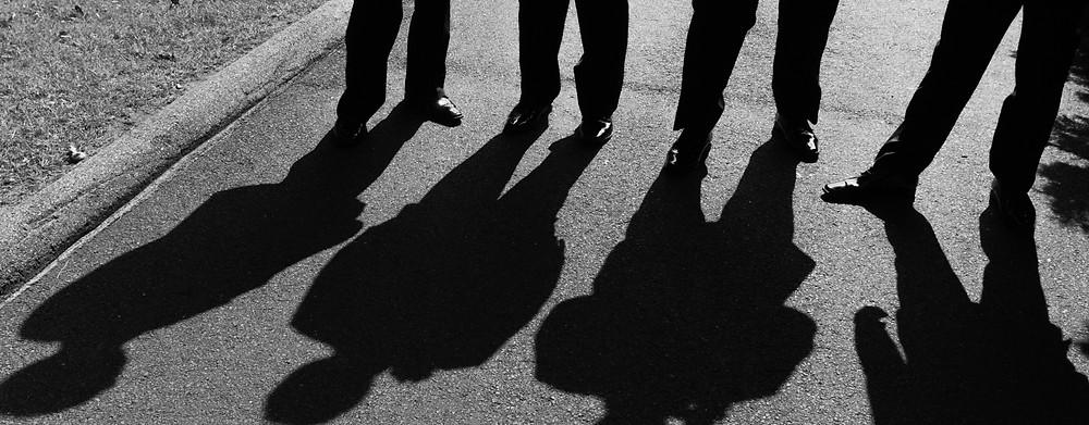 Shadows of 4 groomsmen