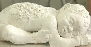 Painter, Roland Mikhail, conceives marble baby
