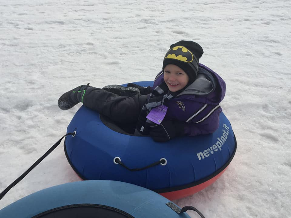My grandson snow tubing to get rid of cabin fever!