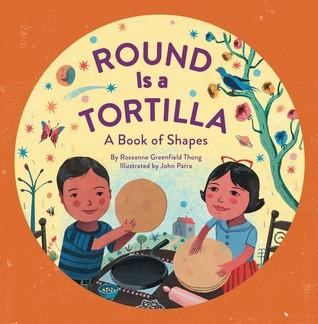 two children make tortillas