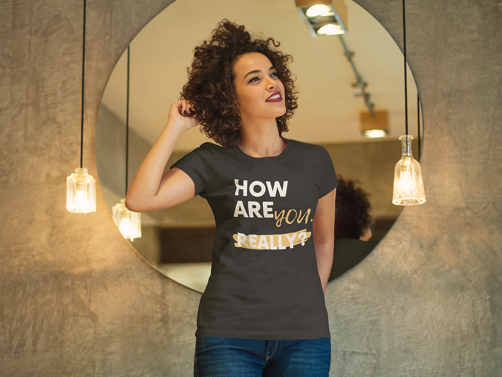 Woman wearing a How are you really tshirt from quiana childress shop online