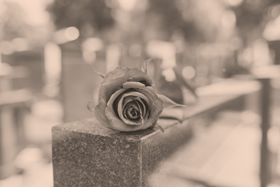 Vintage gravestone with rose for a stillborn child