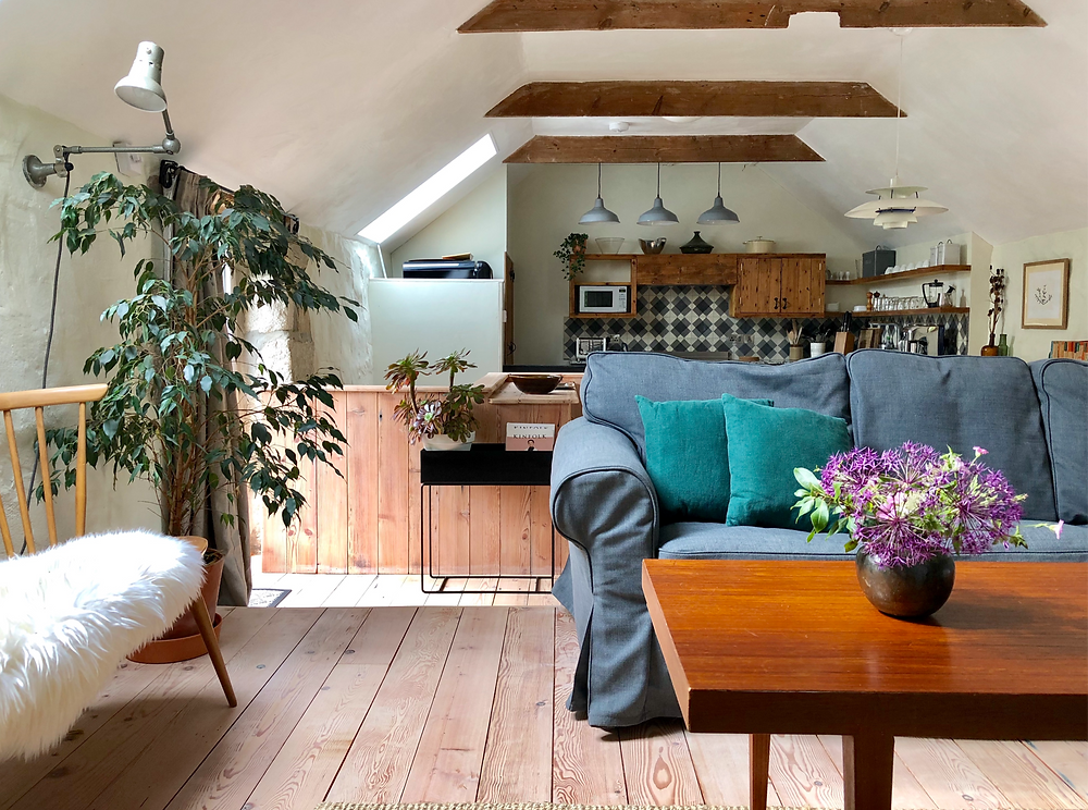 Holiday cottage living room with reclaimed wood floor
