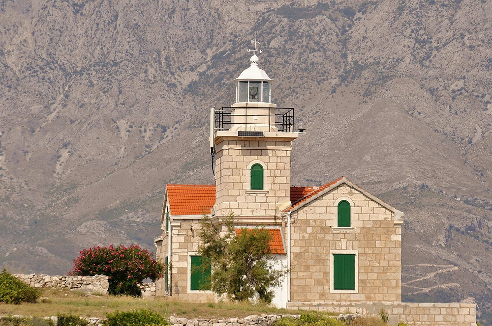 The Lighthouse in Sumartin with Biokovo Mountain in the Background