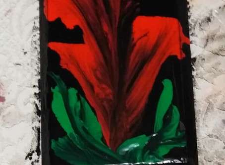 Red flower on wood
