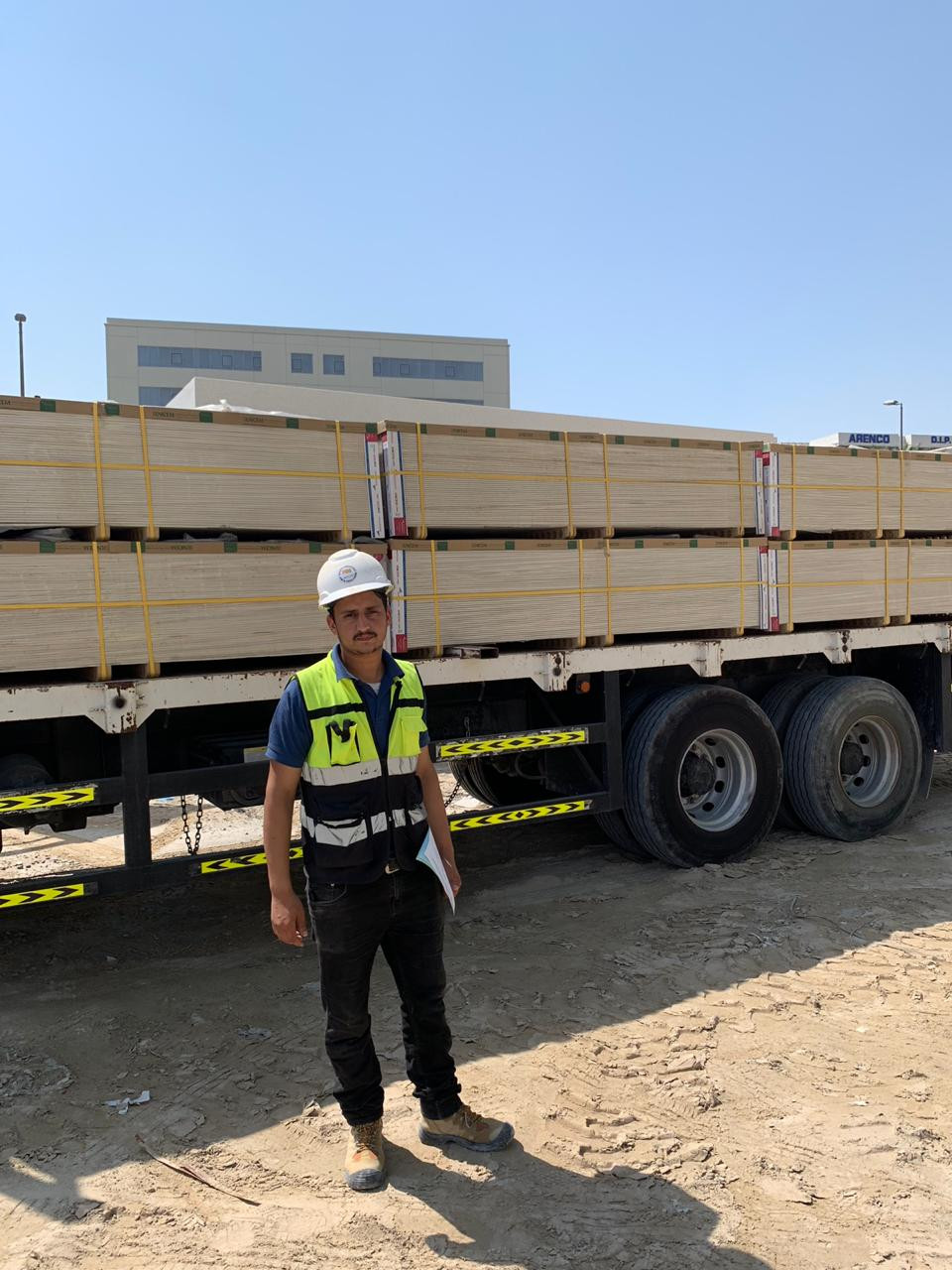 ECOCON storekeeper is accepting cement fibre boards delivered to DIP site