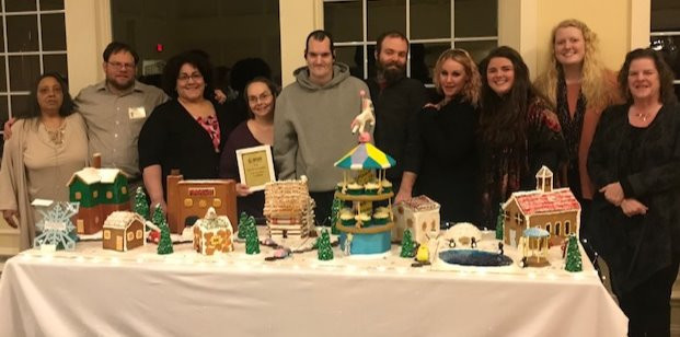 Berkshire Pathways' staff and members stand behind their winter wonderland-themed cupcake creation Feb. 6 at the National Alliance on Mental Illness (NAMI) sixth-annual Cupcake Wars fundraiser at the Berkshire Hills Country Club in Pittsfield, Massachusetts. The team won two prizes.