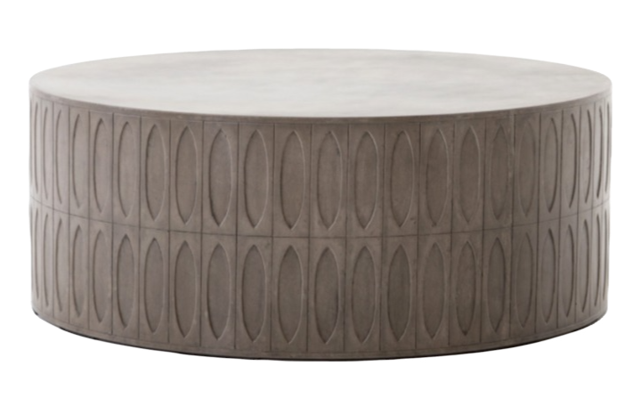 Round, solid, grey concrete coffee table with textural sides