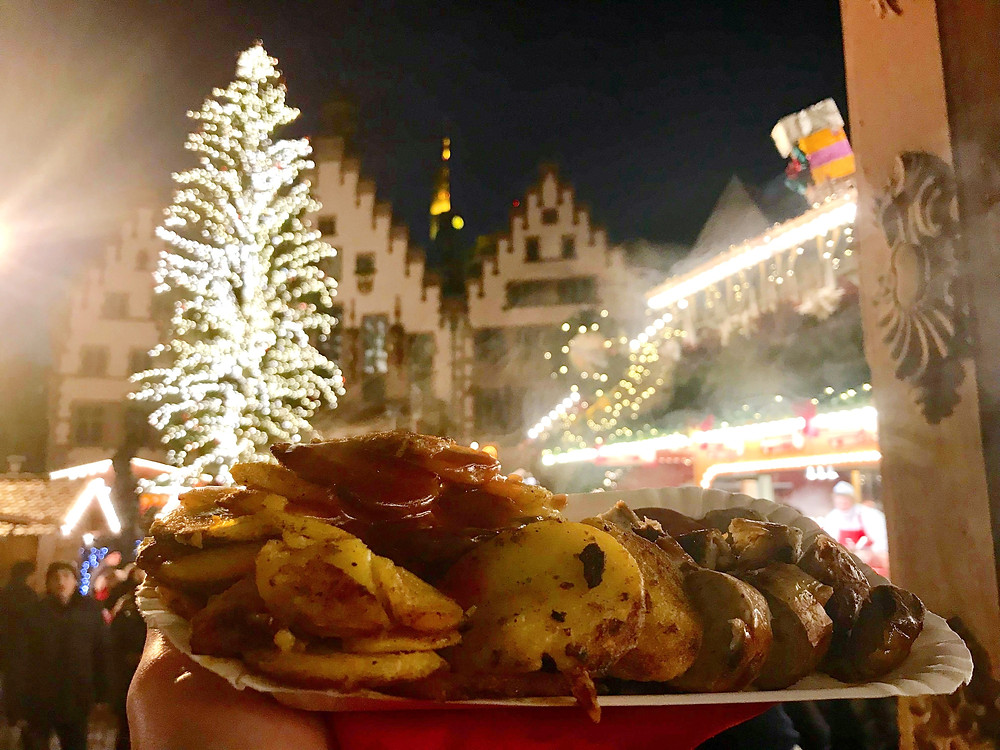 Bratkartoffeln with Bratwurst at the Christmas market in Frankfurt, Germany