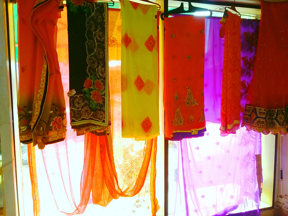 Inside view of an Indian cloth shop, light is coming from outside giving a semitransparent look to SAREE a popular Indian garment worn by Indian women
