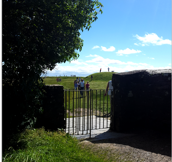 Looking through the churchyard gate towards the Mound of Hostages.