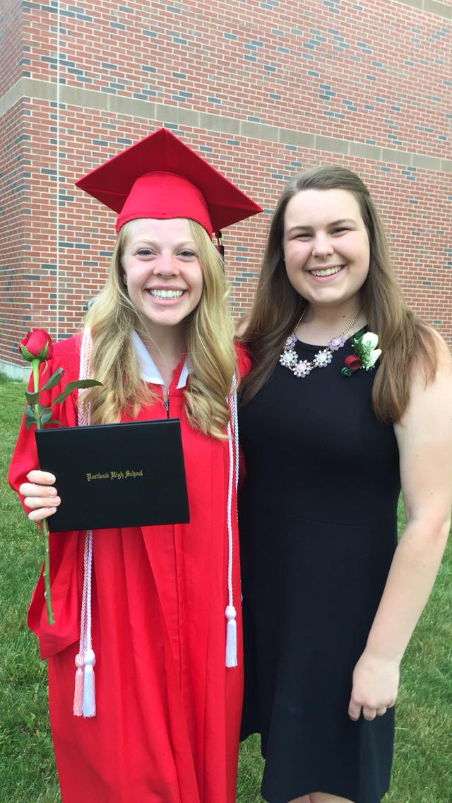 Celebrating my graduation day with my friend, Morgan.