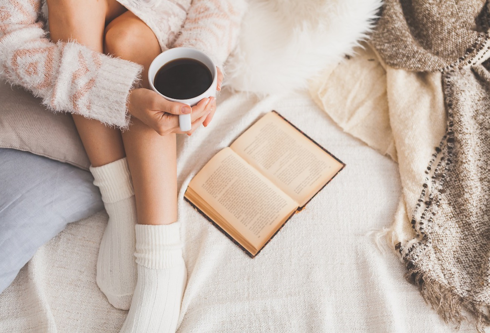 reading while sipping coffee