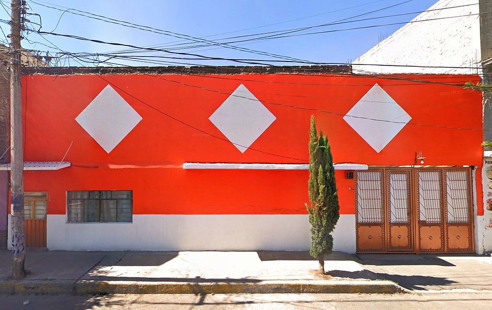 Orange and red house with three red squares