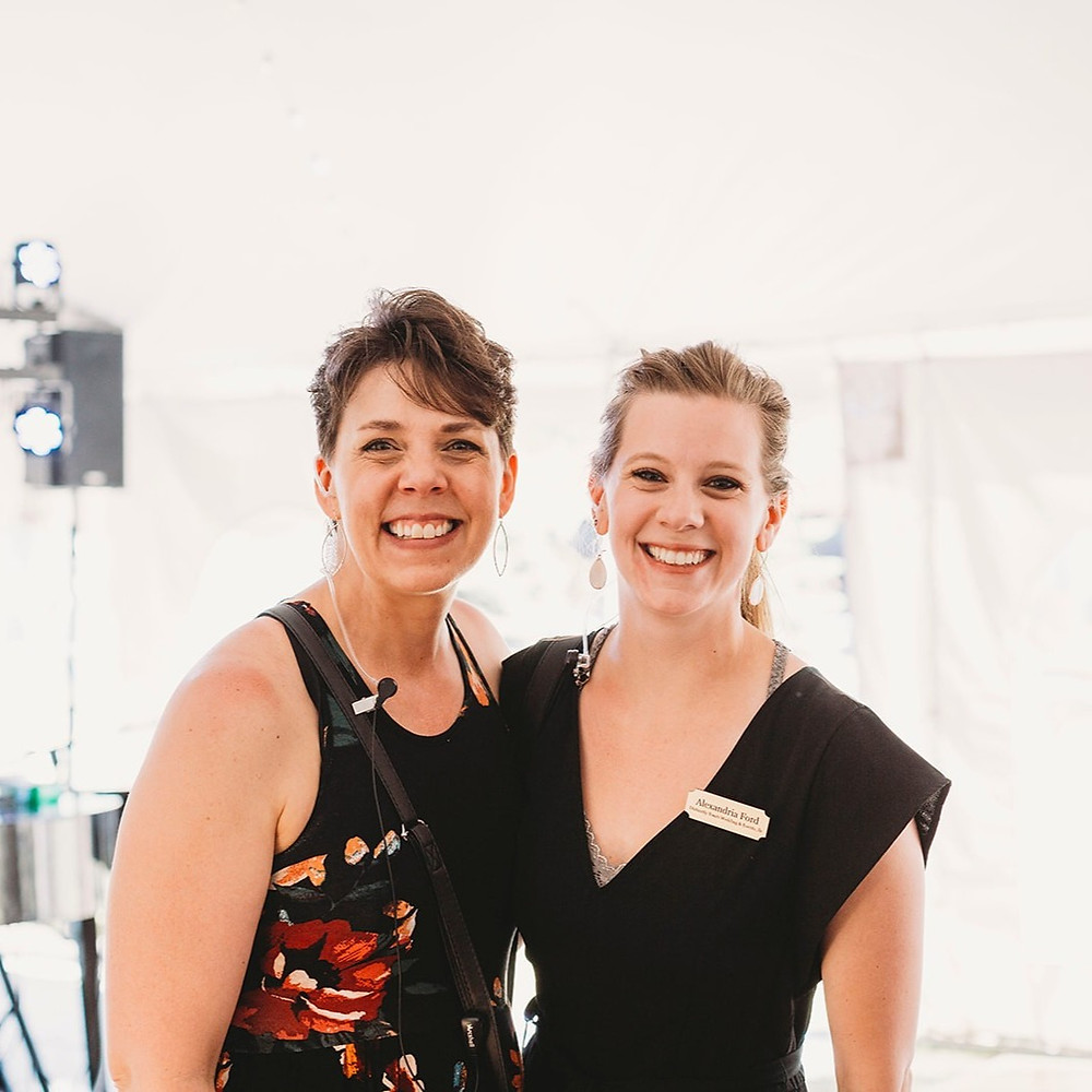 Two women smile at the camera at a wedding in Madison Wisconsin