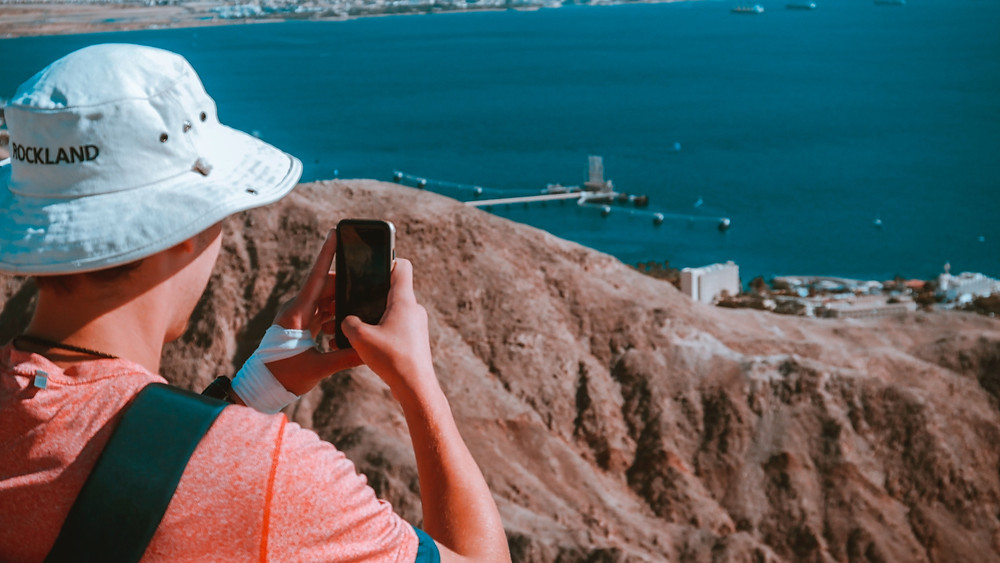 Person taking a photo of Eilat
