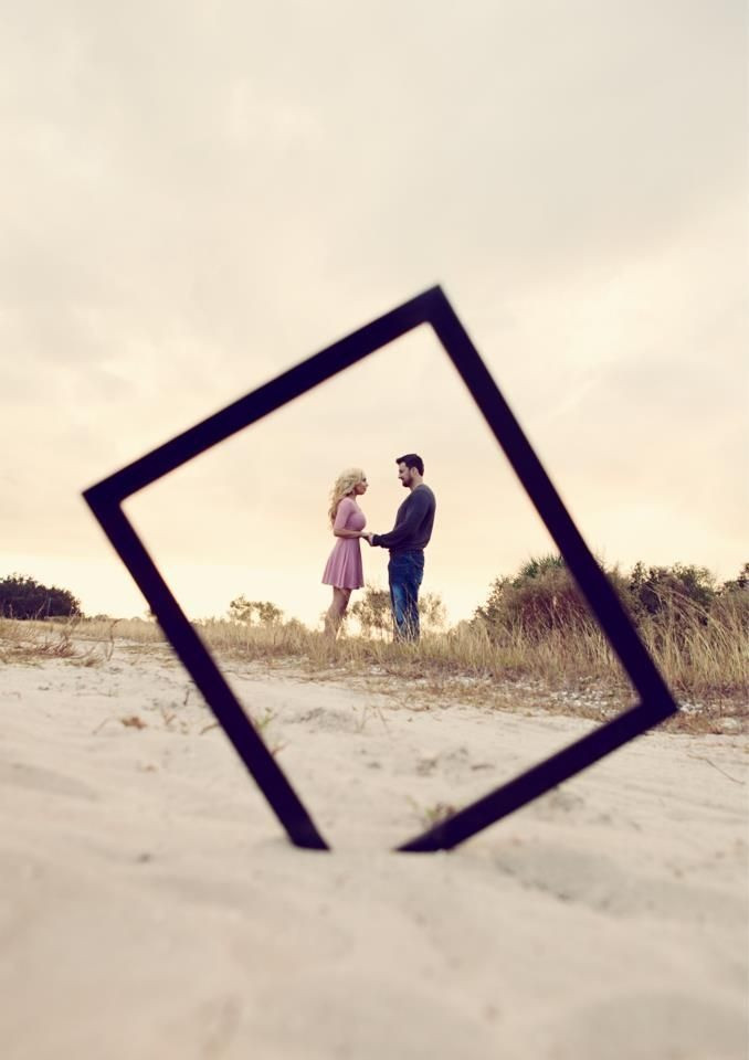 Wedding Photoshoot Props: Photo frame in sand, with couple in the backdrop