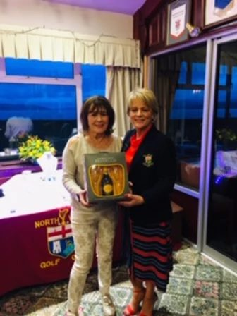 Augusta Neff being presented with her prize by Lady Captain Lorraine