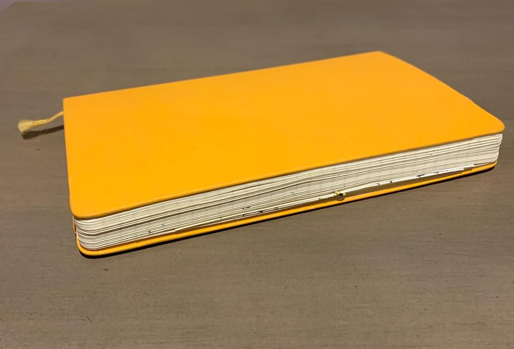 Yellow Moleskine notebook