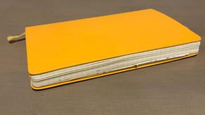 The yellow Moleskine notebook