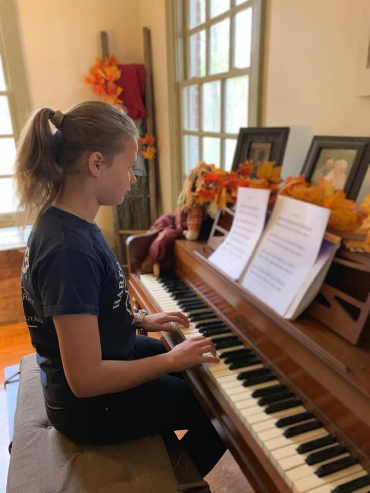 playing piana at homeschool music and arts class