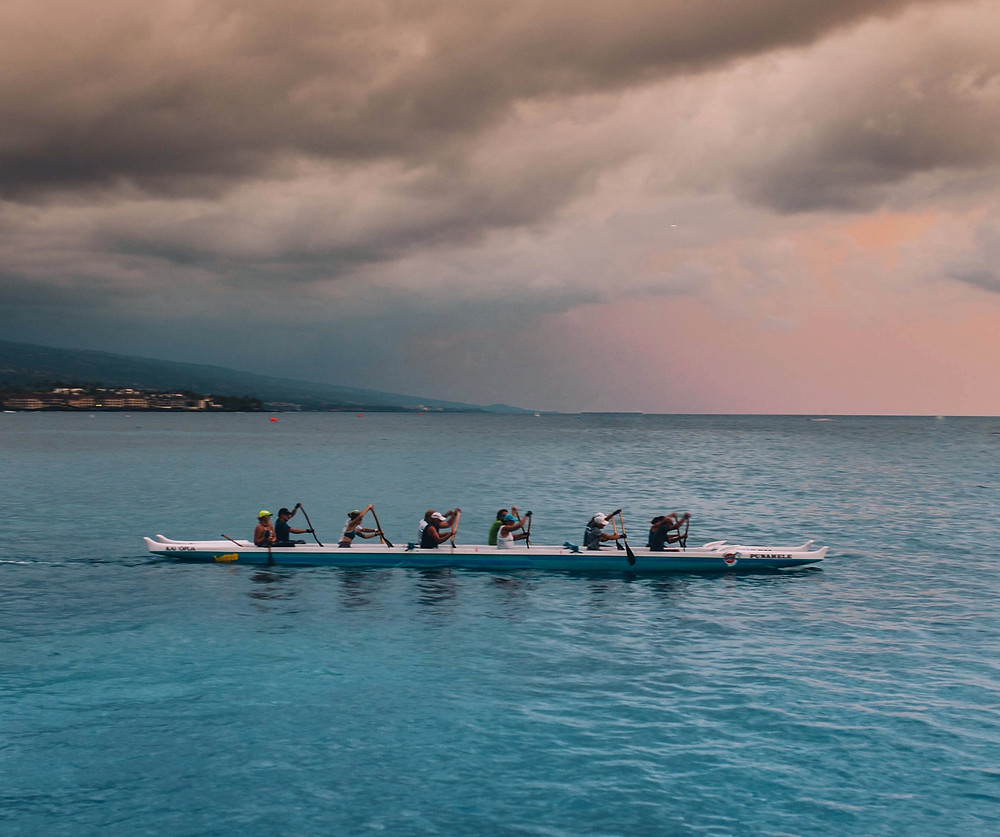 A team of rowers working together to win a race