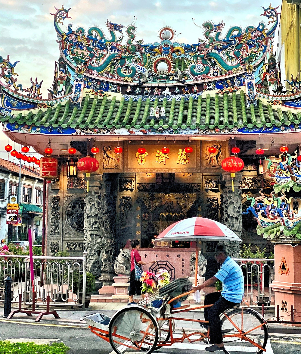 Sunrise stroll in George Town, Penang Island. The ceramic roof on this temple is a beautiful sight to behold.