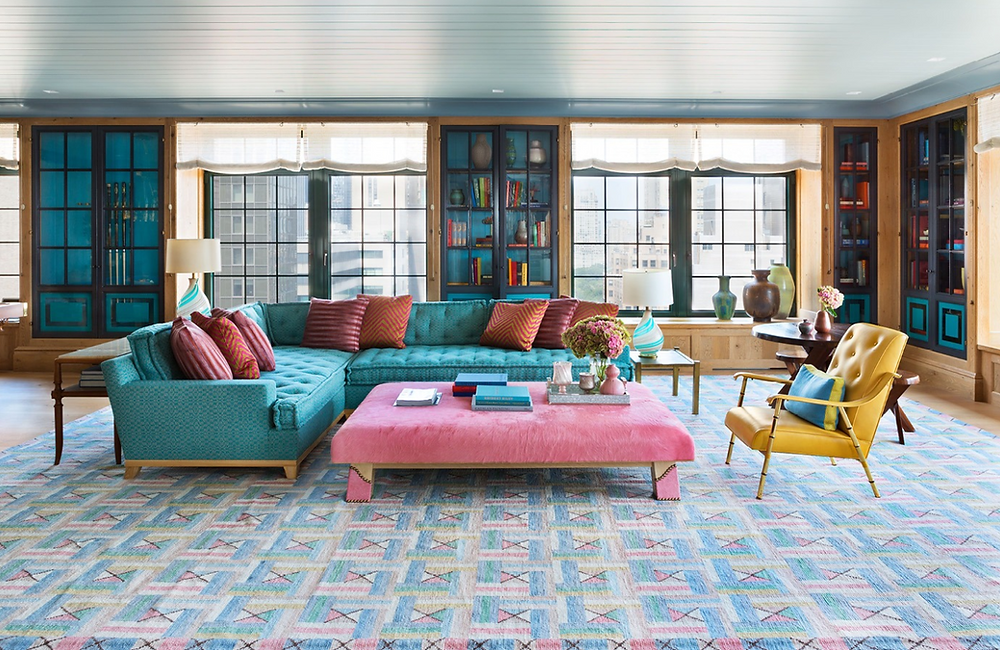 Steven Gambrel, Steven gambrel rug, rug, carpet, flooring, furniture grouping, blue couch, pink ottoman, blue and pink living, blue rug, patterned rug, geometric rug,