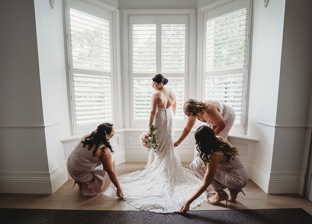 a bride preparing on her wedding day with friends